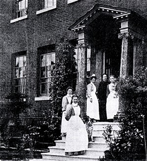 Photo:Staff on front steps of Ivy House, c.1909.